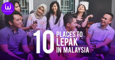 Group of friends hanging out with title 10 places to lepak in Malaysia with Wonderfly logo