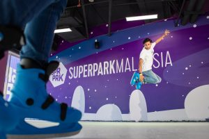 A skater performing in the Ice Skating Rink at SuperPark Malaysia