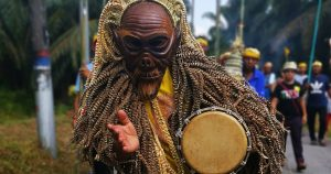 Men dressed in their famous Mah Meri mask