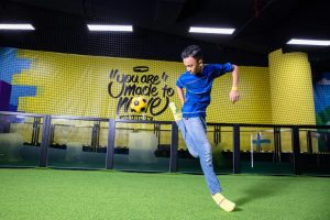 A freestyler showing off tricks at the Street Soccer Court