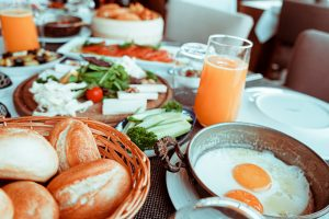 Eggs, bread and juice set on a table