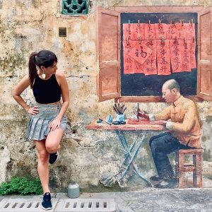 A mural of an old calligrapher in Kwai Chai Hong