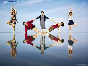 A group of friends strike a creative pose on the Sky Mirror