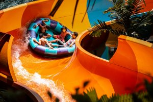 a family slides down a tube at Sunway Lagoon waterslide