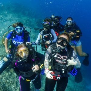 TRACC divers posing for a photo underwater during an excursion