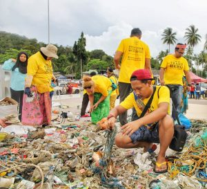 Trash Hero Malaysia volunteers clears up discarded waste on a beach